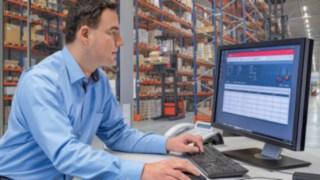 Fleet manager looking at screen showing connect: fleet management software
